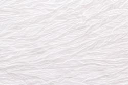 White wrinkled old silk. Thin tissue. Silk fabric texture background. Shabby chik