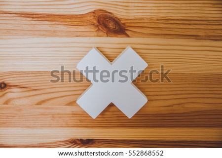 "White ""x"" sign on the wooden background #552868552"