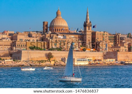 White yacht and Old town of Valletta with churches of Our Lady of Mount Carmel and St. Paul's Anglican Pro-Cathedral, Valletta, Capital city of Malta Stock photo ©