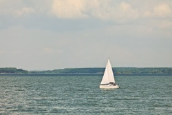 white yacht in blue sea