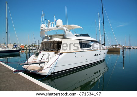 White yacht in the port waiting. On the sea is calm. #671534197