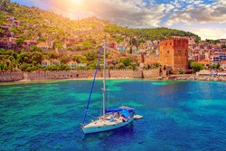 White yacht in the sea bay. Harbor of the Red Tower Alanya, Turkey. Holidays at sea. The coast of Turkey.