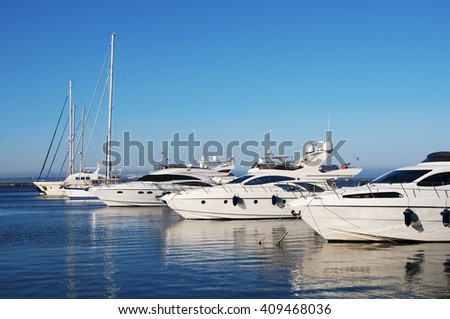 White yachts in the port stock photo