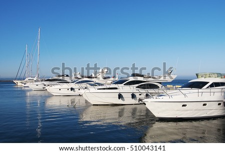 White yachts in the port waiting. On the sea is calm. #510043141