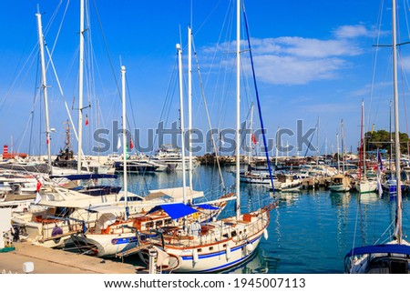White yachts in the sea harbor of Kemer, Antalya province in Turkey. Kemer Marina on the Mediterranean sea Stok fotoğraf ©
