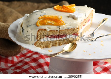 White yoghurt cake with oranges served on white plate