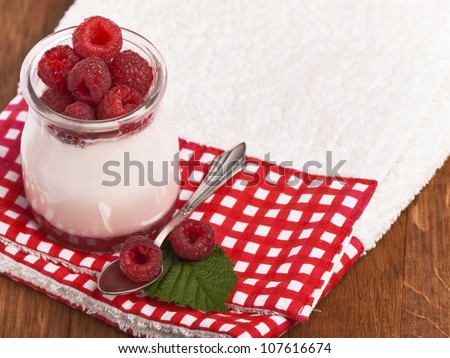 White yogurt with strawberry and spoon