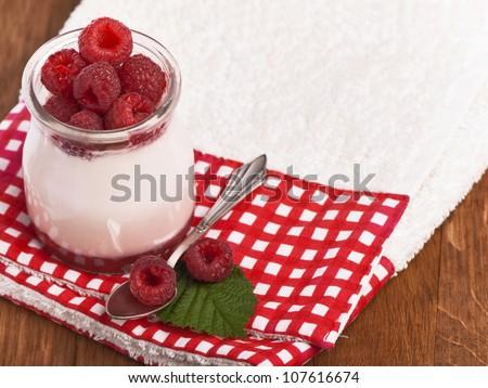 White yogurt with strawberry and spoon - stock photo