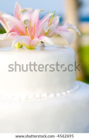 stock photo Whites Wedding Cake with Casablanca Lily flower topper
