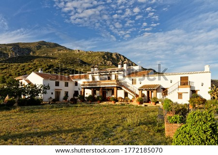 Whitewashed country house with courtyard in the Spanish countryside , Finca Cortijo Las Monjas,Malaga,Andalusia, Spain.Blue sky warm evening at sunset Stock fotó ©