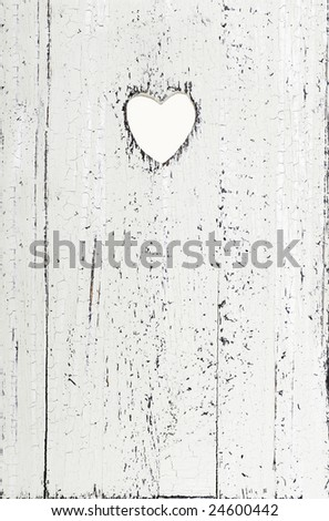 whitewashed grainy wood with heart cut out