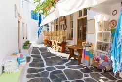 whitewashed narrow street in Mykonos island, Cyclades, Greece