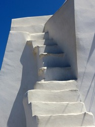 Whitewashed stairs in Greece with blue Sky