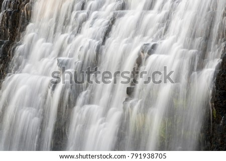 Whitewater cascades down a rocky cliff at Thunder Bay Falls near Galena, Illinois. #791938705