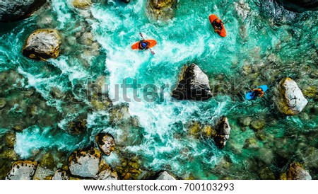 whitewater kayakers on the...