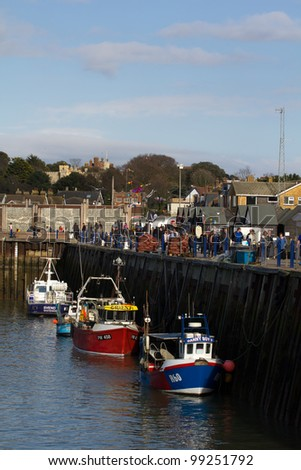 WHITSTABLE, UK - MAR. 13: People visit Whitstable Harbor for the annual Oyster fair on the Mar 13, 2012 in Whitstable, UK