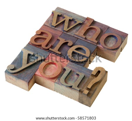 Who are you  question in vintage letterpress printing blocks, stained by color inks, isolated on white