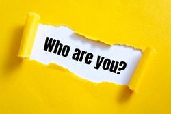 Who are you? question written under torn paper.