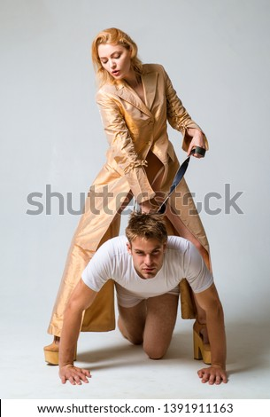 Who is boss here. Dominating foreplay sexual game. Woman and man playing domination games. Love relations and dominating. Concept of sexual domination or bondage. Dominant woman. Submissive guy.