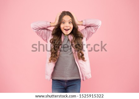 Whoa. Autumn surprise. Surprised kid on pink background. Surprised child in fashion autumn style. Small girl wear long brunette hair with surprised look. Surprised and shocked.