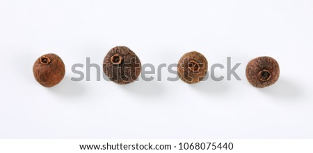 whole allspice berries on white background #1068075440