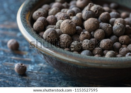 Whole Allspice in a Bowl #1153527595