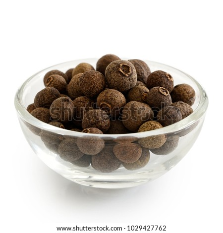 Whole allspice in glass bowl isolated on white. #1029427762