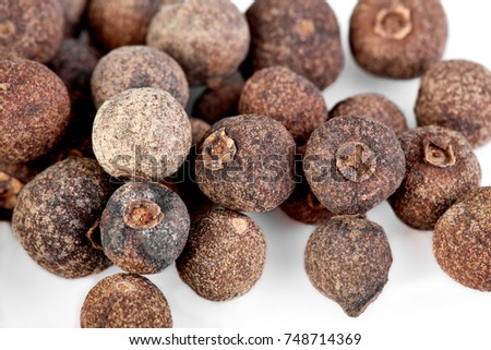 whole allspice isolated on white background. Aromatic allspice. #748714369