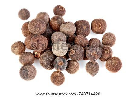 whole allspice isolated on white background. Aromatic allspice. #748714420