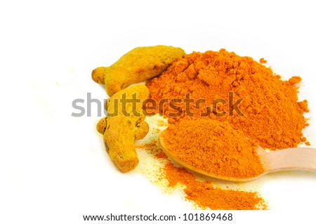 whole an powder of turmeric in a spoon arranged on white background - stock photo