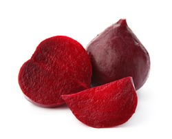 Whole and cut boiled red beets on white background