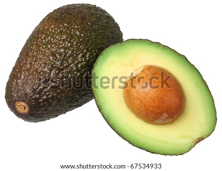 Whole and half avocado isolated on white.
