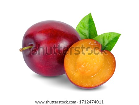 whole and half of cherry red plum with leaf isolated on white background Foto stock ©