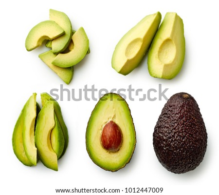 Whole and sliced avocado isolated on white background. Top view