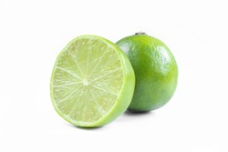 Whole and sliced limes isolated on white background. Sour green fruit