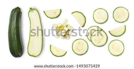 Whole and sliced zucchini isolated on white background. Top view.