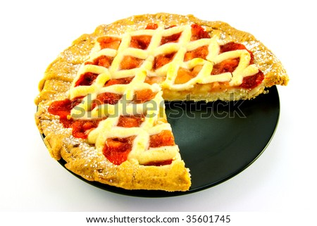 Whole apple and strawberry pie on a black plate with a slice missing on a white background