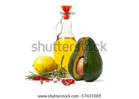 whole avocado, lemon, rosemary and spices isolated on white background