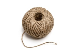 Whole ball of natural colored jute twine for arts and crafts projects isolated on a white background