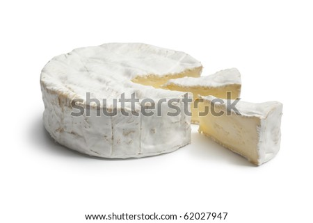 Whole Camembert cheese and pieces on white background