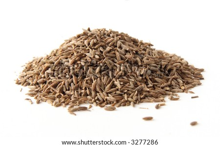 whole cumin seeds, isolated on white. Shallow depth of field, focused on the centre of the pile.