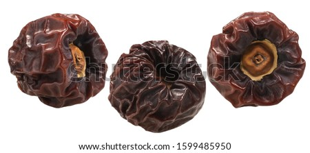 Whole Dried or sun-dried persimmons (Diospyros kaki fruits), isolated