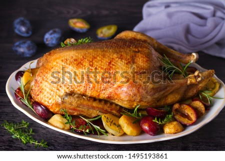 Whole duck with potatoes, plums and herbs Сток-фото ©