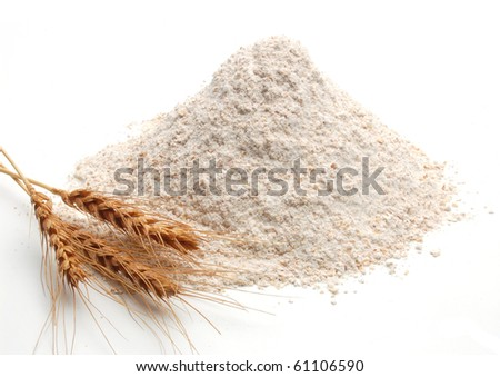 Whole flour and wheat ears on white background