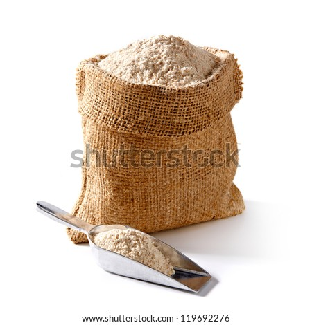 Whole flour in bag with scoop on white background