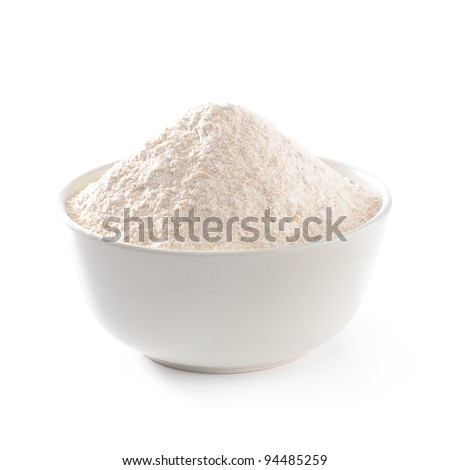 Whole flour in bowl on white background