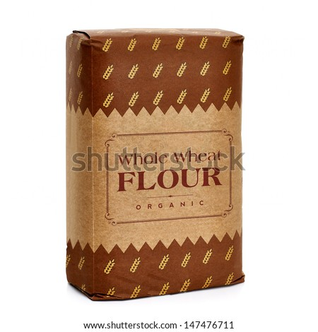 Whole Flour In Paper Bag On White Background