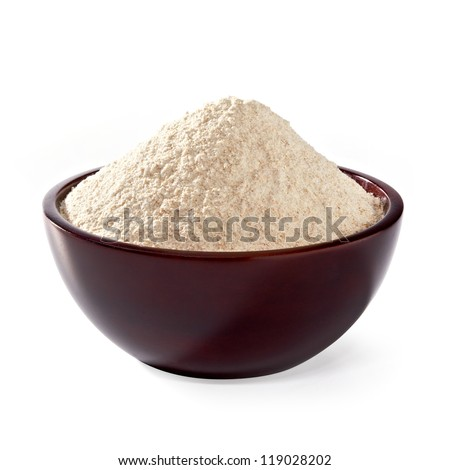Whole flour in wooden bowl on white background