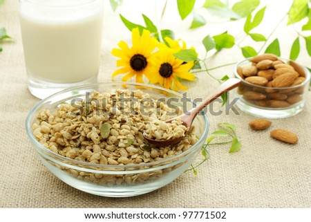 Whole grain cereal with milk and almonds