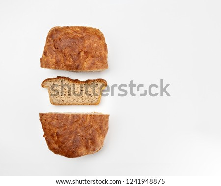 Whole grain or whole wheat bread, slices of homemade bread on white background. Top view #1241948875